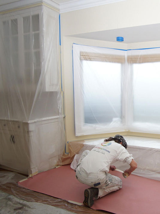 man prepare for painting of entire house
